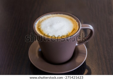 Coffee cup on the table at the coffee shop. - stock photo