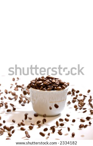 Coffee cup on with beans, on white background with falling beans - stock photo