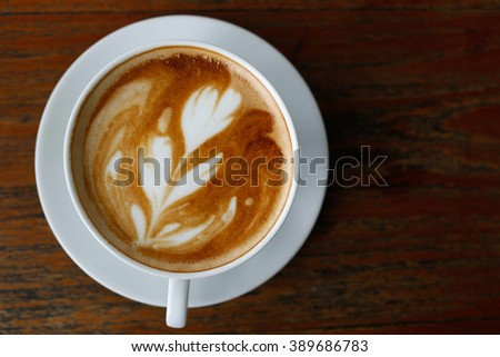 Coffee cup on wood table top view - stock photo