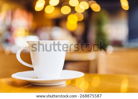 Coffee cup on wood table - vintage effect style pictures - stock photo