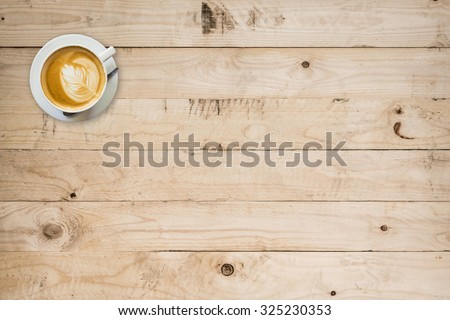 coffee cup on wood table with space - stock photo