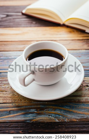 Coffee cup on wooden background - vintage effect - stock photo