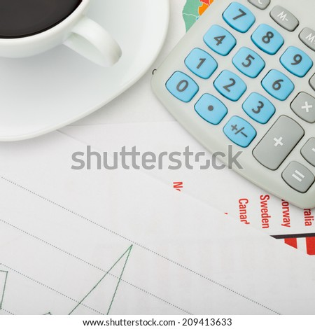 Coffee cup over some financial documents - view from top - 1 to 1 ratio - stock photo