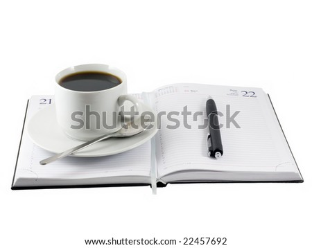 Coffee cup,pen, standing on the opened organizer. white. Isolated on white. - stock photo