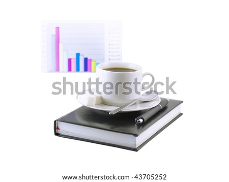 Coffee cup, standing on the personal organizer, on a back background-financial  diagram . Isolated - stock photo