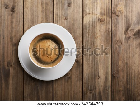 Coffee cup top view on old wooden background - stock photo