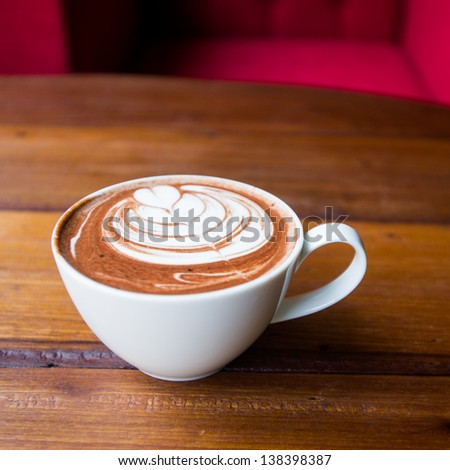 coffee cup top view on wood table - stock photo