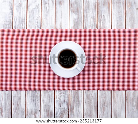Coffee cup top view on  wooden and tissue - stock photo
