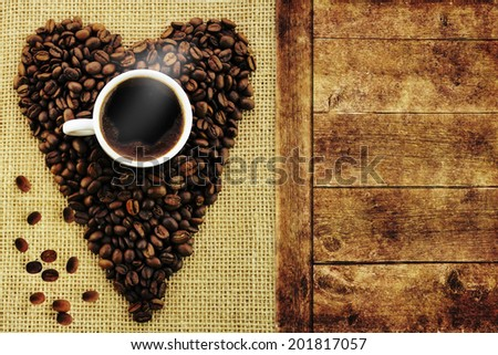Coffee cup with coffee beans. - stock photo