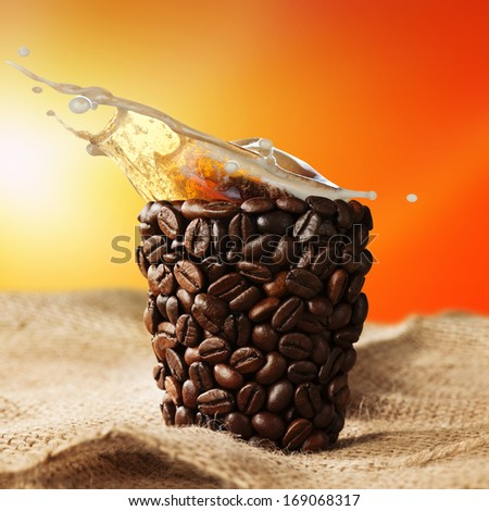 coffee cup with coffee splash - stock photo