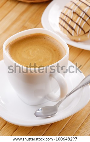 Coffee cup with cookie sandwich on the table - stock photo