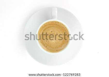 Coffee cup with foam and cream on a plate isolated on white background - stock photo