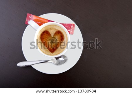 coffee cup with heart made with foam - stock photo