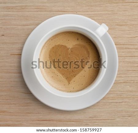 coffee cup with heart shape on foam - stock photo