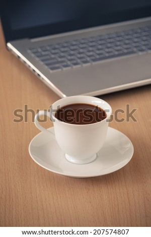 Coffee Cup with Laptop on Table for Business - stock photo