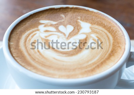 Coffee cup with latte art - stock photo