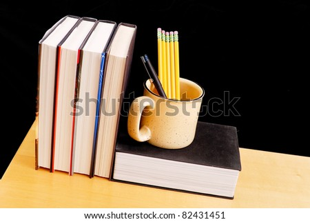 Coffee Cup with Pencils and Pen - stock photo