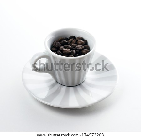 coffee cup with roasted beans on white background - stock photo