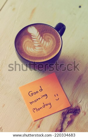 coffee cup with text good morning Monday vintage color tone - stock photo