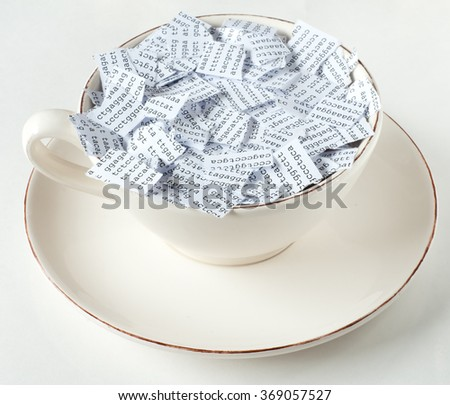 Coffee cup with torn DNA sequence in it - stock photo