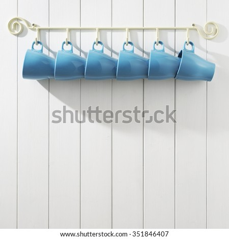 coffee cups on white wall - stock photo