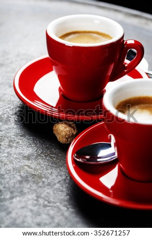 Coffee Espresso. Red Cups Of Coffee on dark background - stock photo