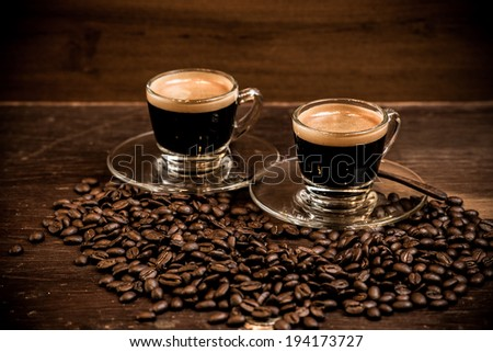 coffee espresso with coffee bean on wooden background - stock photo