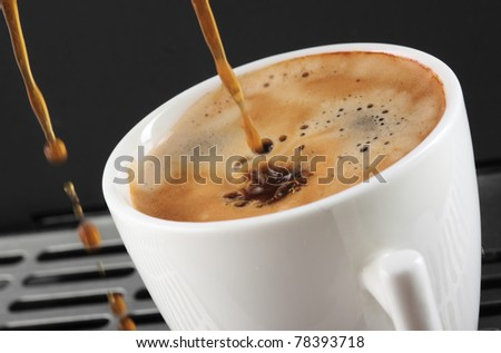 coffee expresso being poured into a mug- blurry movement- - stock photo