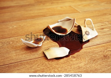 Coffee, flowed out from the broken cup - stock photo
