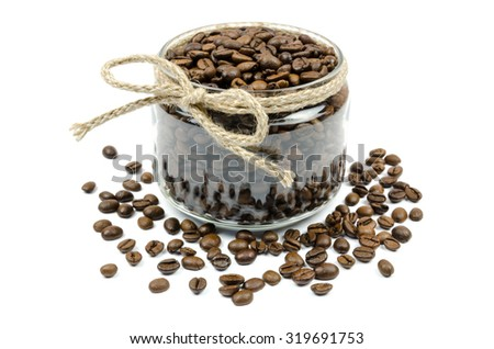 coffee grains jar with a bow on a white - stock photo