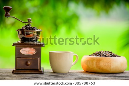 Coffee grinder and coffee beans - stock photo