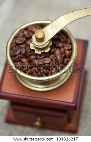 coffee grinder on burlap - stock photo