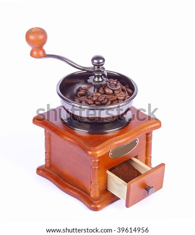 Coffee-grinder with coffee beans on white background - stock photo