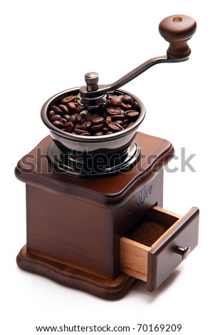 Coffee grinder with coffee beans over white background - stock photo