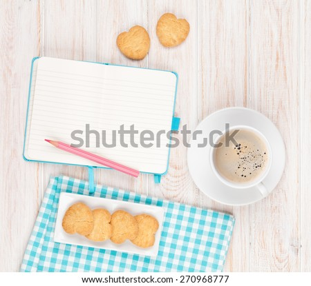 Coffee, heart shaped cookies and notepad on white wooden table with copy space - stock photo