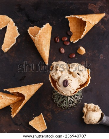Coffee ice cream in a waffle cone on a dark background.selective focus - stock photo
