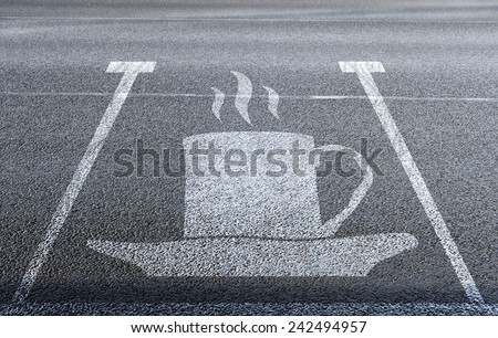 coffee icon on the parking lot - stock photo