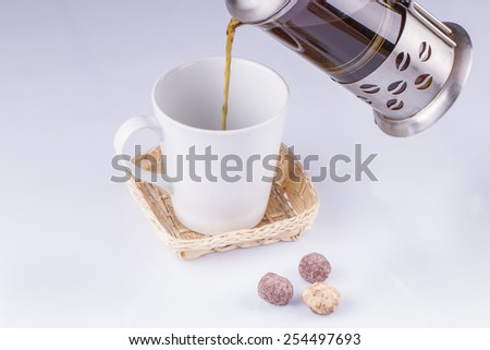 Coffee in a French Press on White Backgorund - stock photo