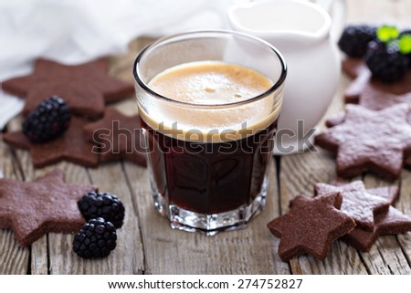 Coffee in a glass with whole wheat chocolate cookies - stock photo