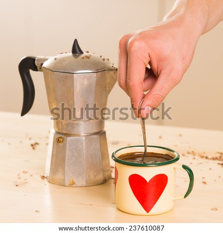 Coffee in Italian style on a wooden table. Kitchen - stock photo