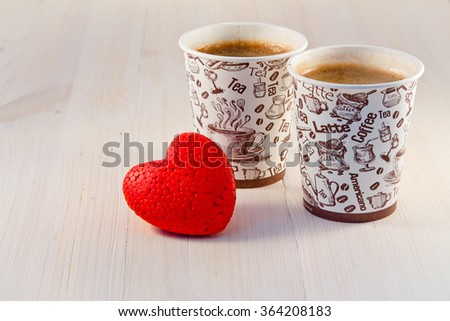 Coffee in paper cups and heart  - stock photo