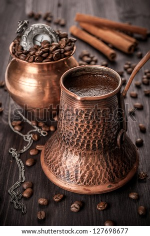 Coffee in the pot, coffee beans and vintage watches. Still life. - stock photo