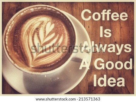 Coffee inspirational quotation with latte or cappuccino as background   - stock photo