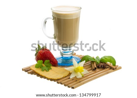 Coffee Late with Flower, mint, star-anise, cheese, strawberry and cinnamon - stock photo