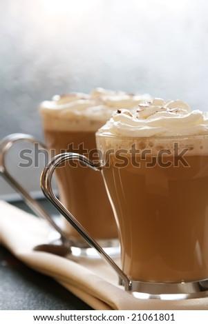 coffee latte macchiato with cream in glasses on window background, shallow DOF - stock photo