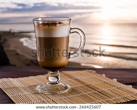 coffee latte on the sunrise background, selective focus - stock photo