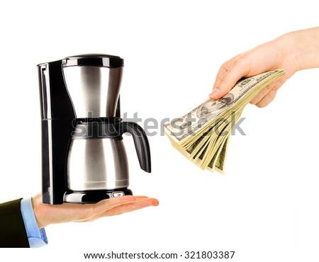 Coffee machine and money on hands- pawnshop concept - stock photo