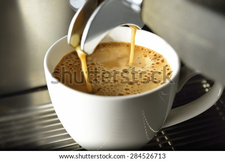 Coffee machine making espresso coffee in coffee shop - stock photo