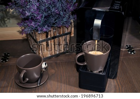 Coffee machine pouring in cup. brewing some coffee. - stock photo