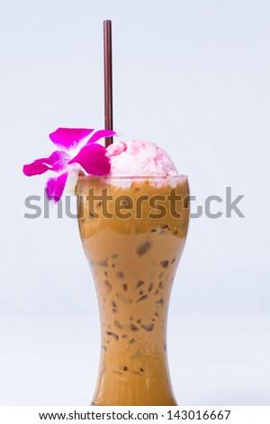 Coffee milk with  strawberry ice cream float on white background - stock photo
